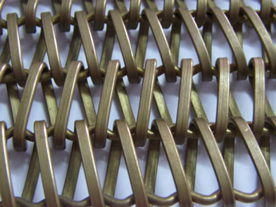 A brass balanced weave conveyor belt on the white background.
