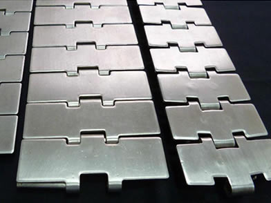 Three stainless steel chain plate conveyor belt on the white background.