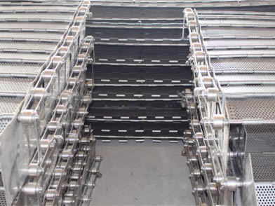 Several perforated plate conveyor belt on the ground.