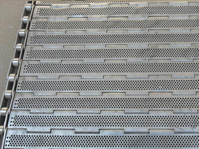 A front side of perforated plate conveyor belt on the ground.